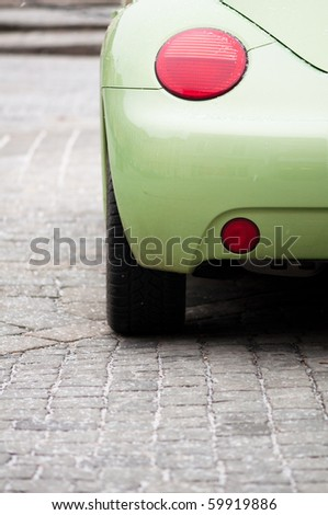 trendy green car's tail light - stock photo