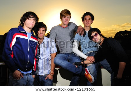 Trendy group  of young casual teenagers posing - stock photo