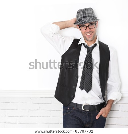 Trendy guy wearing black and white - stock photo