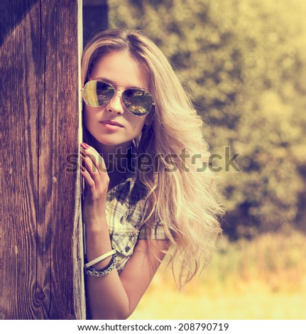Trendy Hipster Girl in Sunglasses. Summer Modern Youth Lifestyle. Toned Photo. - stock photo