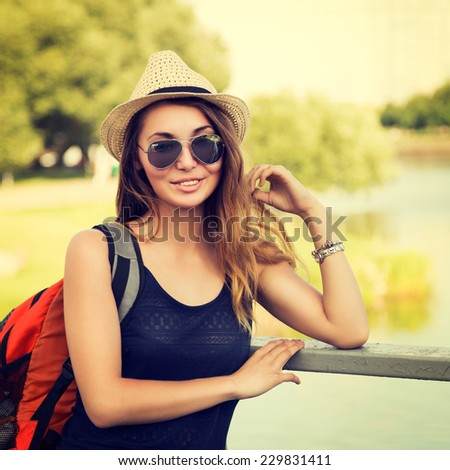 Trendy Hipster Girl Relaxing in the Park. Toned and Filtered Instagram Styled Photo. Modern Youth Lifestyle Concept. - stock photo