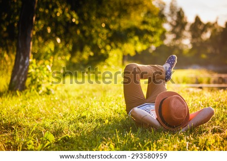 Trendy Hipster Girl Relaxing on the Grass - stock photo