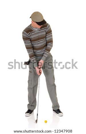 Trendy looking young male golfer, studio shot, reflective surface - stock photo