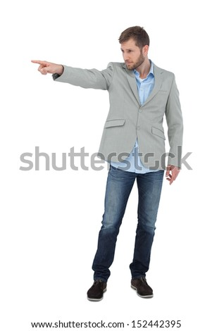 Trendy model pointing to something on white background