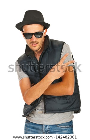 Trendy rapper with hat and sunglasses gesturing isolated on white background - stock photo