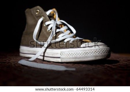 trendy sport shoe highlighted on black background - stock photo