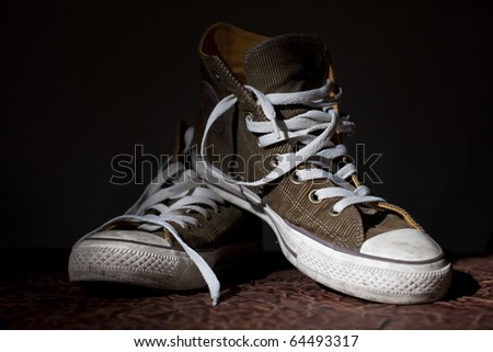 trendy sport shoes on a black background - stock photo