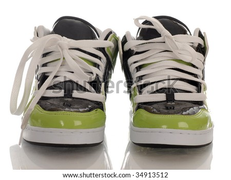 trendy style of skateboarding shoes with reflection on white background - stock photo