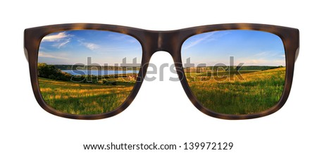 Trendy sunglasses with a reflection of a beautiful landscape isolated on white