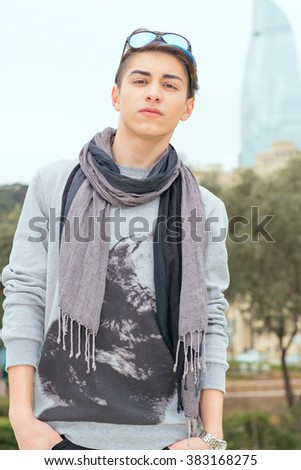 trendy teen boy outdoors with sunglasses in cool weather - stock photo