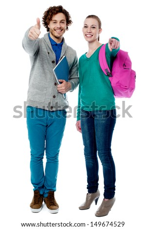 Trendy university students posing together