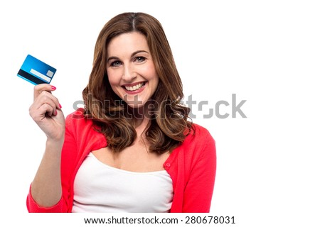 Trendy woman showing her credit card - stock photo