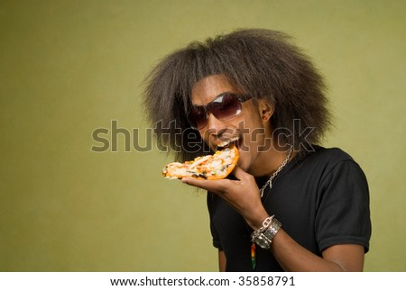 Trendy Young African American Male Posing with Some Pizza - stock photo