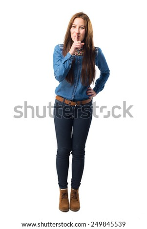 Trendy young woman doing the silence gesture. Over white background - stock photo