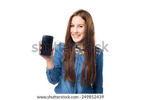 Trendy young woman showing a smart phone. Over white background - stock photo