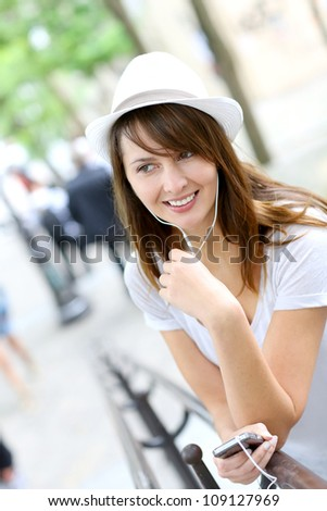Trendy young woman using smartphone in public park - stock photo