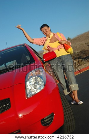 Trendy, youthful senior with her brand new car, happy and proud - stock photo