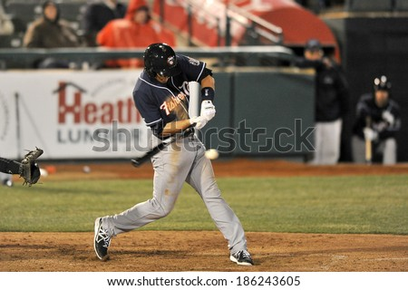 TRENTON, NJ - APRIL 4: New Hampshire Fisher Cats batter Kevin Nolan (23) gets jammed on an inside pitch during the Thunder home opener April 4, 2014 in Trenton, NJ.  - stock photo