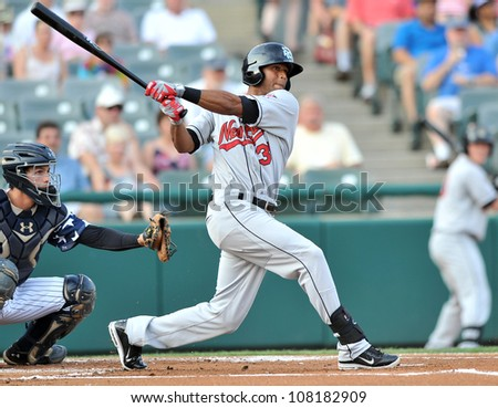TRENTON, NJ - JULY 4: New Britain center fielder Aaron Hicks swings at a pitch during the Easter League baseball game July 4, 2012 in Trenton, NJ. - stock photo