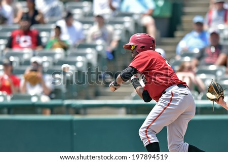 TRENTON, NJ - JUNE 8: Altoona Curve shortstop Alen Hanson (22) pulls the bat back as the pitch comes in during the Eastern League minor league baseball game played June 8, 2014 in Trenton, NJ.  - stock photo