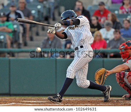 TRENTON, NJ - MAY 11: Trenton batter Jose Toussen swings at a pitch during an Eastern League game against Portland May 11, 2012 in Trenton, NJ. - stock photo