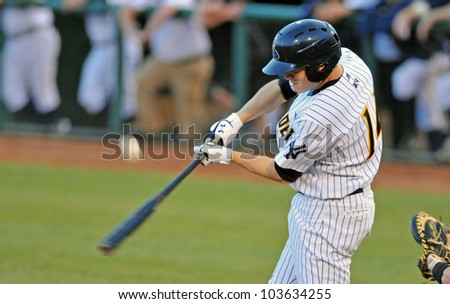 TRENTON, NJ - MAY 23: Trenton designated hitter Corban Joseph connects with a pitch during the Eastern League baseball game against the Akron Aeros May 23, 2012 in Trenton, NJ. - stock photo