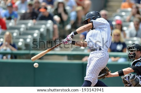 TRENTON, NJ - MAY 11: Trenton Thunder second baseman Robert Refsnyder fouls off a pitch during the Eastern League game May11, 2014 in Trenton, NJ. - stock photo