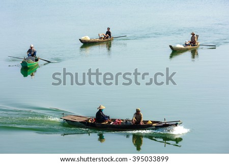 Tri An Lake, Dong Nai Province, Vietnam - March 6, 2016 : the fishermen's boats on the lake in the early morning. This is the fishermen who live in the fishing village of Tri An Lake