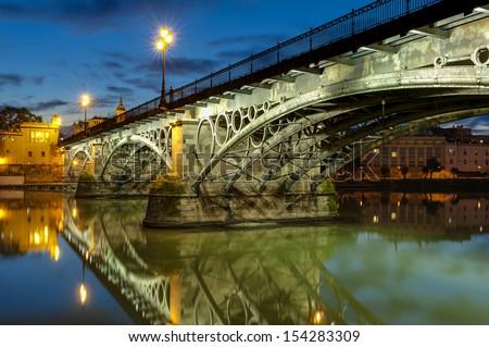 Triana Bridge Sevilla at dusk - stock photo