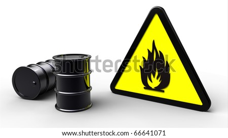 Triangle flammable hazard sign next to black barrels - stock photo