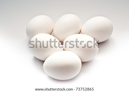 triangle of eggs on a grey background