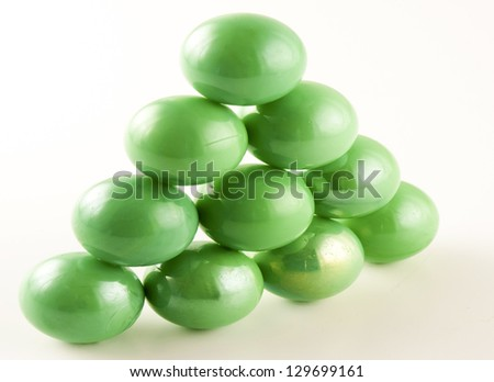 triangle of green marbles