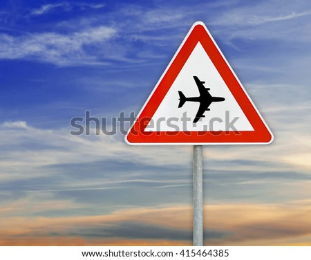 Triangle on rod  road sign plane airport with cloudy sky - stock photo