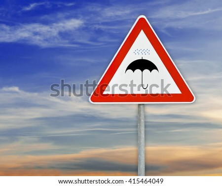 Triangle road sign umbrella on rod with cloudy sky