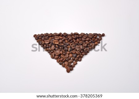 Triangle shape of roasted coffee beans on white background. Love coffee. Morning pleasure