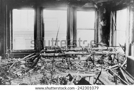Triangle Shirtwaist Factory interior, destroyed sewing machines, gutted by a fire that killed 146 on March 15, 1911. Managers locked fire exits to prevent thefts, trapping immigrant women workers. - stock photo
