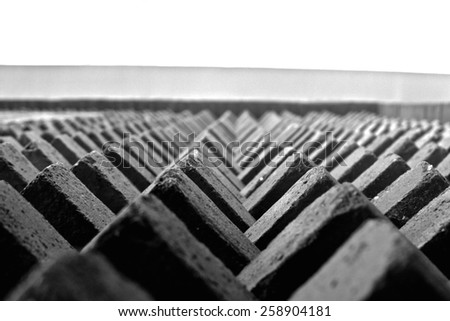 Triangular bricks piling to the top of a building
