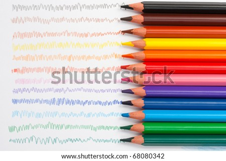 Triangular color pencils with hand-drawn lines. - stock photo