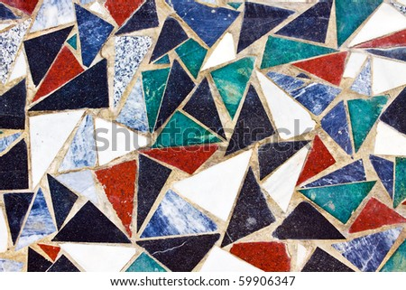 Triangular colorful mosaic texture on the wall - stock photo