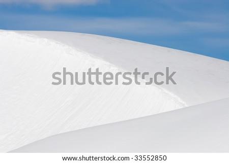 triangular layers of pristine snow - stock photo
