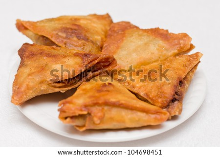 Triangular shaped Ethiopian fried lentil Samosa served on a plate - stock photo