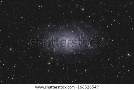 Triangulum Galaxy (M33) in Triangulum constellation against starry night sky