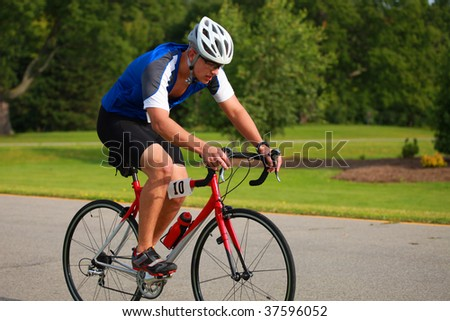 Triathlete Cycling - stock photo