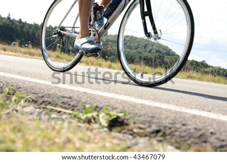 triathlete on bicycle with slight motion blur - stock photo