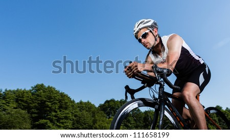 triathlete on the bicycle - stock photo