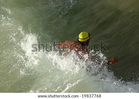 Triathlete swimming in the sea - stock photo