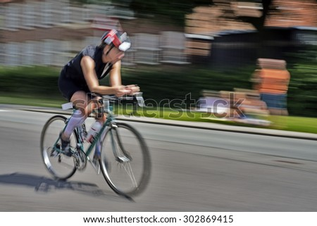 Triathlon bike race cyclists at high speed - stock photo
