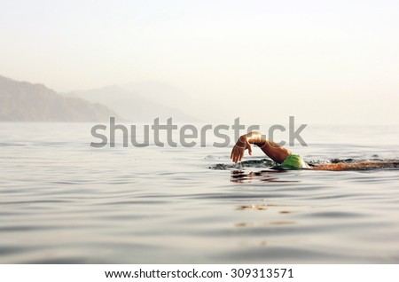 Triathlon swimmer at sea - stock photo