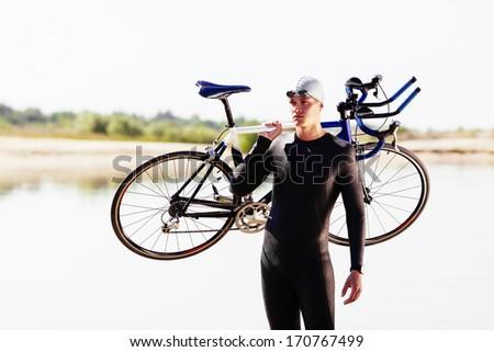 Triathlonist preparing for the bike race - stock photo