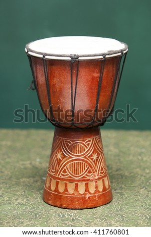 Tribal Drum on green background - stock photo
